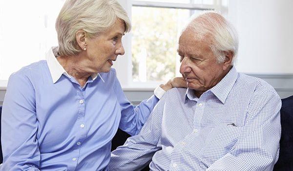 Elderly woman consulting an elderly man