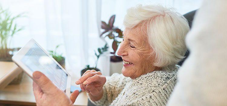Elderly woman on smart tablet
