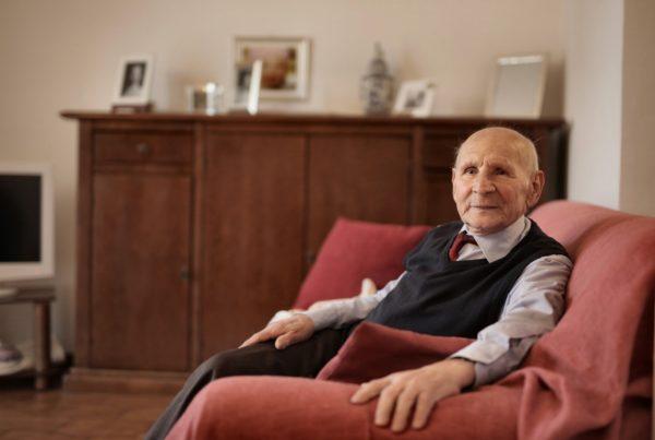elderly gentleman sat on chair